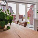 Select Windows Referentie Rijsbergen - Kunststof kozijnen in nieuwbouwwoning - kunststof tuindeuren met zijlichten